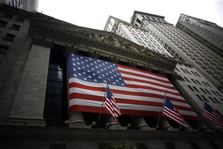 A flag hangs outside the New York Stock Exchange September 22, 2008. REUTERS/Eric Thayer