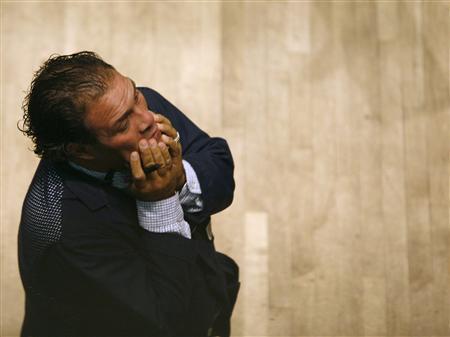 Trader Gregg Russo works on the floor of the New York Stock Exchange, September 25, 2008. REUTERS/Brendan McDermid