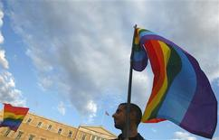 <p>A protester waves a rainbow flag during a protest outside the Greek parliament in Athens September 29, 2008. Dozens of gays and lesbians protested outside parliament on Monday against the conservative government's attempt to overturn Greece's first same-sex marriages. REUTERS/Yiorgos Karahalis</p>