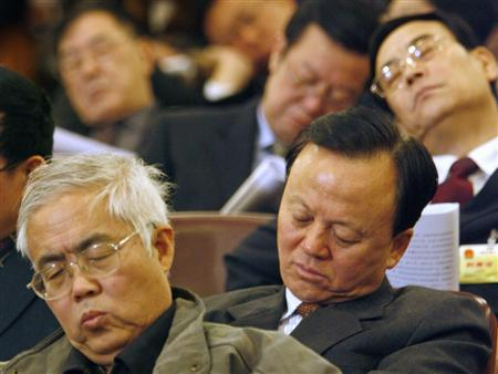 Delegates doze during the opening of the National People's Congress in Beijing March 5, 2007. REUTERS/Claro Cortes IV