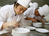 <p>Students prepare plates for desserts during a class at a culinary school in Manila September 23, 2008. The Philippines, which for decades has supplied the world's labour pool with a steady stream of seafarers, nurses, caregivers, and domestic helpers, is now offering the world a fresh wave of workers: chefs. REUTERS/Cheryl Ravelo</p>