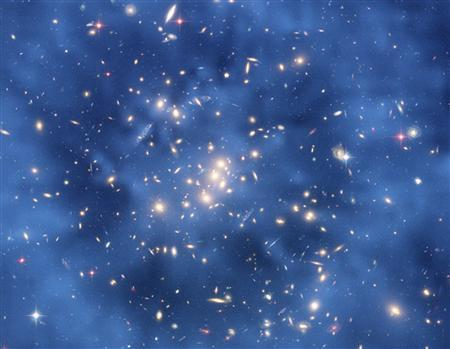 This undated image from the Hubble Space Telescope shows a ghostly ring of dark matter in a galaxy cluster designated Cl 0024+17. REUTERS/NASA, ESA, M.J. Jee and H. Ford/Johns Hopkins University/Handout