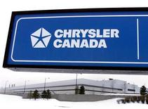 <p>A sign frames the exterior of the DaimlerChrysler Bramalea plant in Brampton, Ontario, January 29, 2001. REUTERS/Andrew Wallace</p>
