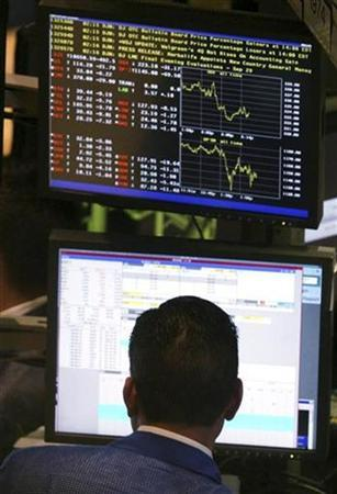 A trader watches screens as he works on the floor of the New York Stock Exchange, September 29, 2008. REUTERS/Brendan McDermid