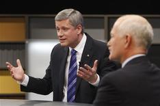 <p>Conservative leader and Prime Minister Stephen Harper (L) makes a point as NDP leader Jack Layton looks on during the French leaders' debate in Ottawa, October 1, 2008. Canadians will head to the polls in a federal election October 14. REUTERS/Chris Wattie</p>