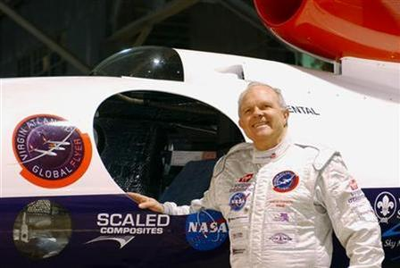Record-breaker Steve Fossett poses by his aircraft the morning of his attempt to fly the first solo, non-stop round the world flight in the Virgin Atlantic GlobalFlyer February 28, 2005. REUTERS/ Dave Kaup/Files