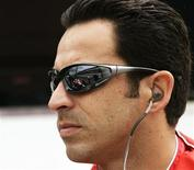 <p>Driver Helio Castroneves of Brazil, pole sitter for the 91st Indianapolis 500, watches his crew work on his car during practice time at the Indianapolis Motor Speedway in Indianapolis May 16, 2007. REUTERS/Brent Smith</p>