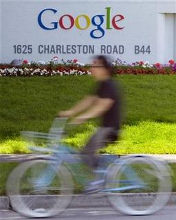 A man rides his bike past Google Inc. headquarters in Mountain View, California, May 8, 2008. REUTERS/Kimberly White