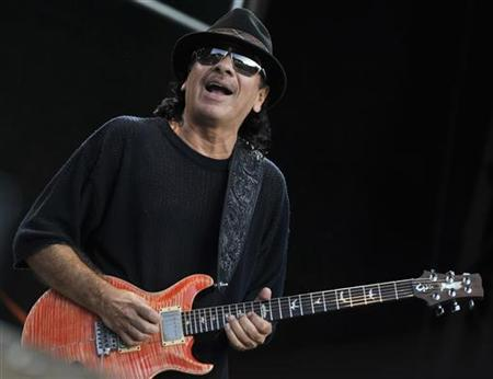 Carlos Santana performs on the stage during this year's ''Connection'' concert, an admission-free event organised annually by Hungary's telecommunications provider T-Mobile in Budapest, June 28, 2008. REUTERS/Stringer