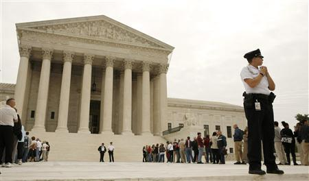 People wait to get into the Supreme Court in Washington October 6, 2008. REUTERS/Kevin Lamarque