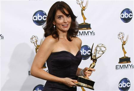 Tina Fey holds one of her two Emmys she won for outstanding writing for a comedy series and for outstanding lead actress in a comedy series for ''30 Rock'' at the 60th annual Primetime Emmy Awards in Los Angeles, September 21, 2008. REUTERS/Mike Blake