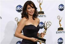 "<p>Tina Fey holds one of her two Emmys she won for outstanding writing for a comedy series and for outstanding lead actress in a comedy series for ""30 Rock'' at the 60th annual Primetime Emmy Awards in Los Angeles, September 21, 2008. REUTERS/Mike Blake</p>"