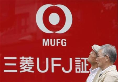 Pedestrians walk past a signboard of a Mitsubishi UFJ Financial Group (MUFG) securities branch in Tokyo, September 23, 2008. REUTERS/Issei Kato