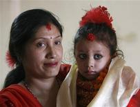 <p>Matina Shakya, after being appointed as the new living goddess or Kumari, is seen with her mother Sunita Shakya in Kathmandu October 7, 2008. REUTERS/Gopal Chitrakar</p>