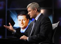 <p>Conservative leader and Canada's Prime Minister Stephen Harper speaks during a television interview in Toronto October 7, 2008. Canadians will head to the polls in a federal election on October 14. REUTERS/Chris Wattie</p>