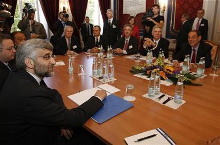 Iran's chief nuclear negotiator Saeed Jalili (L) smiles before a meeting on nuclear issues with E.U. foreign policy chief Javier Solana (R) at the Town Hall in Geneva July 19, 2008. REUTERS/Denis Balibouse