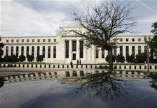 <p>The Federal Reserve Building is reflected on a car in Washington September 16, 2008. REUTERS/Jim Young</p>