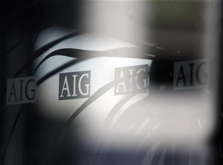 The logo of American International Group (AIG) is seen at their offices in New York, September 18, 2008. REUTERS/Eric Thayer