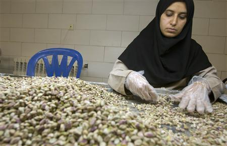 A worker sorts pistachios by hand during a final inspection before packing at a processing factory in Rafsanjan, southeast of Tehran, September 23, 2008. REUTERS/Caren Firouz