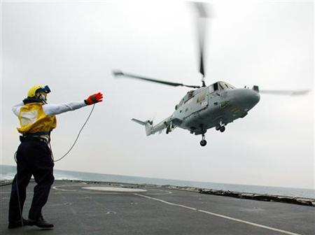 A helicopter takes off from a Royal Navy destroyer in a file photo. REUTERS/Stephen Hird