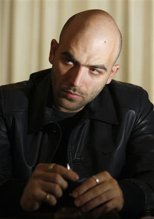 Italian anti-mafia writer Roberto Saviano,29, speaks to a reporter in Rome in this file photo taken April 7, 2008. Police in Italy are looking into reports that the Naples mafia plans to carry out its threat to kill the author of the best-selling book ''Gomorra'', which has been made into a hit movie about mafia brutality, by Christmas. REUTERS/Alessandro Bianchi/Files