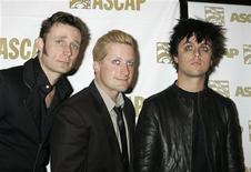 <p>Members of the pop group 'Green Day' (L-R) Mike Dirnt, Tre Cool and Billie Joe Armstrong pose at the American Society of Composers, Authors and Publishers (ASCAP) Pop Music Awards in Beverly Hills, California May 22, 2006. REUTERS/Fred Prouser</p>