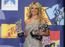 "<p>Britney Spears poses backstage with her three awards for best pop video, video of the year and best female video for ""Piece of Me"" at the 2008 MTV Video Music Awards in Los Angeles September 7, 2008. REUTERS/Phil McCarten</p>"