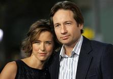 "<p>Cast member Tea Leoni and her husband David Duchovny attend the Los Angeles premiere of Columbia pictures' ""Fun with Dick and Jane"" at the Mann Village theatre in Los Angeles December 14, 2005. REUTERS/Mario Anzuoni</p>"