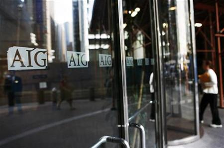 A woman enters the American International Group (AIG) offices in New York September 17, 2008. REUTERS/Shannon Stapleton