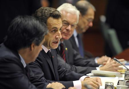 (L-R) France's Prime Minister Francois Fillon and President Nicolas Sarkozy, whose country currently holds the rotating Presidency of EU, European Parliament Chairman Hans-Gert Poettering and EU Foreign Policy Chief Javier Solana attend a European Union leaders summit in Brussels, October 15, 2008. REUTERS/Pool/Gerard Cerles