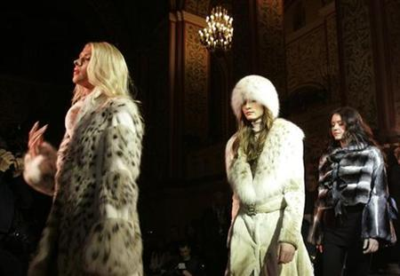 Models present fur creations during a fur fashion show at the Supreme Luxury Conference in Moscow November 29, 2007. REUTERS/Alexander Natruskin