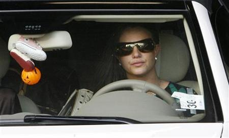 Britney Spears drives her Mercedes Benz as she leaves the Stanley Mosk Courthouse garage after a child custody hearing with her ex-husband regarding her two sons in Los Angeles, California October 26, 2007. REUTERS/Fred Prouser