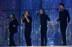 <p>Take That's (L-R) Howard Donald, Gary Barlow, Mark Owen and Jason Orange perform at the Brit Awards at the Earls Court Arena in London February 14, 2007. REUTERS/Kieran Doherty</p>