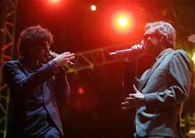 "<p>Michael ""Mike D"" Diamond (L) and Adam ""MCA"" Yauch of the Beastie Boys perform on the main stage during the Exit music festival in Novi Sad, Serbia, July 14, 2007. REUTERS/Marko Djurica</p>"