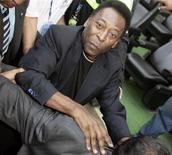 <p>Pelé ao chegar para assistir a uma partida entre o America e o Guadalajara Cheevas, no México REUTERS/Henry Romero(MEXICO)</p>
