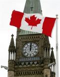 <p>A Canadian flag blows in the wind in front of the Peace Tower on Parliament Hill in Ottawa in this May 22, 2004 file photo. REUTERS/Jim Young</p>