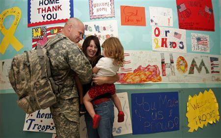 A military family reunites at DFW airport in Dallas, Texas, October 22, 2008. REUTERS/Jessica Rinaldi
