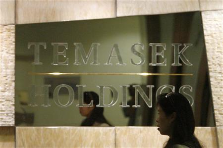 An employee walks past a Temasek Holdings sign at the company's headquarters in this file photo. Singapore's state investor has agreed to invest up to 12 billion rupees (94 million pounds) in Pakistan's NIB Bank via a right share issue, NIB said. REUTERS/Vivek Prakash