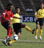 <p>Anggisu Barbosa (L) of East fights for the ball with Mohd Azwan Bin Muhd Saleh of Brunei during their Asean Football Federation Suzuki Cup 2008 soccer qualifier at the Olympic national stadium in Phnom Penh October 21, 2008. After six fruitless years playing international soccer, FIFA's lowest-ranked nation East Timor are beginning to see the romance of the beautiful game. REUTERS/Chor Sokunthea</p>