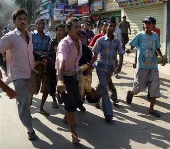 People carry the body of a bomb blast victim while shouting anti-government slogans near the site of one of the bomb blasts in Guwahati, the main city of India's troubled northeastern Assam state, October 30, 2008. REUTERS/Utpal Baruah