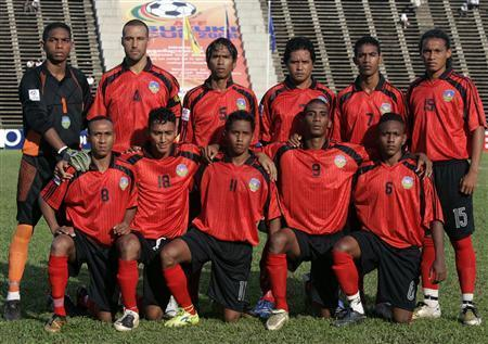 The East Timor national football team pose before their match against Brunei during their Asean Football Federation Suzuki Cup 2008 qualifier at the Olympic national stadium in Phnom Penh October 23, 2008 . After six fruitless years playing international football, FIFA's lowest-ranked nation East Timor are beginning to see the romance of the beautiful game. REUTERS/Chor Sokunthea