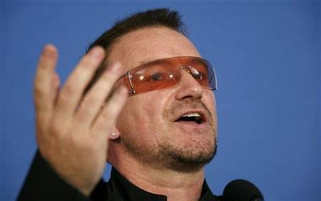 U2 lead singer Bono gestures during a news conference at the Media Centre in Kuehlungsborn near the G8 venue in Heligendamm in this file photo from June 8, 2007. REUTERS/Morris Mac Matzen