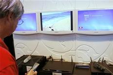 "<p>A man takes a closer look at third party ""Extenders"" that are designed to bring internet content to a television during the DigitalLife consumer electronics show in New York September 27, 2007. REUTERS/Lucas Jackson</p>"