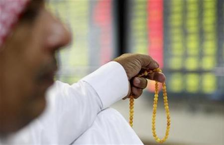 Traders monitor stocks from the trading floor at the Doha Securities Market building in Doha October 19, 2008. REUTERS/Fadi Al-Assaad