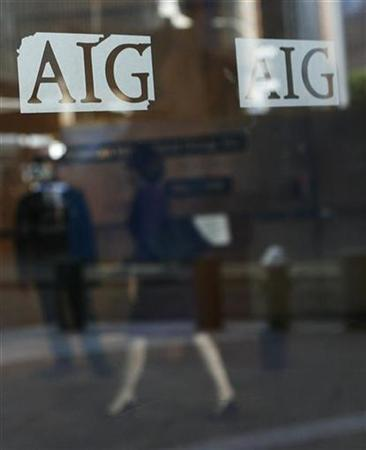 A woman walks inside the American International Group (AIG) offices in New York September 17, 2008. REUTERS/Shannon Stapleton