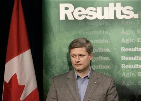 Canada's Prime Minister Stephen Harper waits to speak at a news conference in Vancouver, British Columbia, March 13, 2007. REUTERS/Lyle Stafford