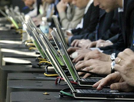 Attendees use computers at a trade show in Atlanta in a file photo. REUTERS/ Tami Chappell
