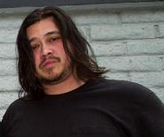 <p>Deftones bassist Chi Cheng poses in a file photo. The bass player with the California rock band is in a coma after being involved in a car accident Monday in Santa Clara, Calif., according to the Sacramento Bee. REUTERS/Ethan Miller</p>