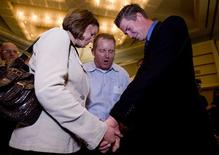 <p>Amanda Stanfield, Jim Domer and J.D. Gaddis (L-R) pray together after it was announced that Proposition 8 passed at a post-election party in Irvine, California November 4, 2008. REUTERS/Fred Greaves</p>