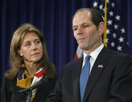 New York Governor Eliot Spitzer stands next to his wife Silda Wall Spitzer as he announces his resignation at his office in New York March 12, 2008. REUTERS/Brendan McDermid